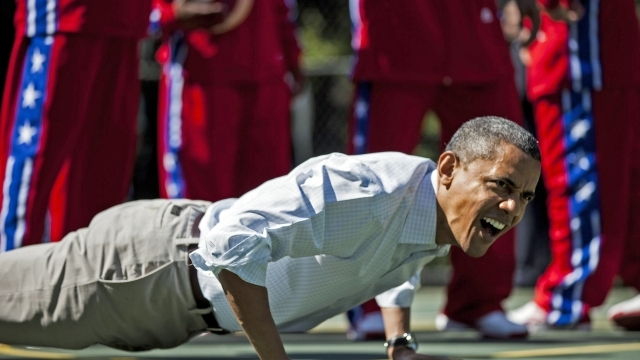 US President Barack Obama does pushups during backetball shooting drills during the annual Easter Egg Roll on the South Lawn of the White House April 9, 2012 in Washington, DC. The First Family participated in the yearly event where the South Lawn is opened up to guests to participate in various egg rolls and other activities. AFP PHOTO/Brendan SMIALOWSKI (Photo credit should read BRENDAN SMIALOWSKI/AFP/GettyImages)